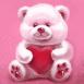 Nounours rose avec un coeur