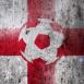 Angleterre : Ballon de foot sur mur grunge