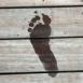 Trace de pied sur les planches