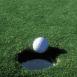 Balle de golf presque rentrée
